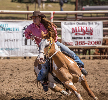 cottonwood: Barrel Rider Cowgirl, Cottonwood Rodeo, California. Editorial