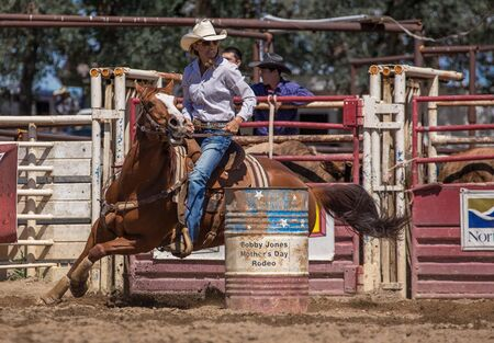 racer: Barrel Racer at the rodeo in Cottonwood, California.