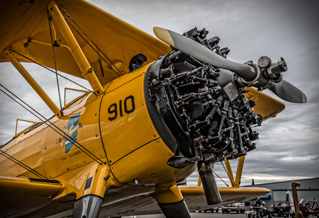 Redding, California, USA- September 28, 2014: A high performance stunt biplane and its engine are on display at an airshow in Northern California.