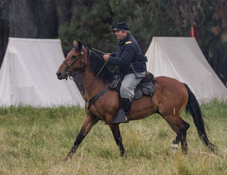 red bluff: Red Bluff, California, United States-April 25, 2015: Union cavalry scouts ride up to the enemy lines and discover rebel positions during a Civil War reenactment. Editorial