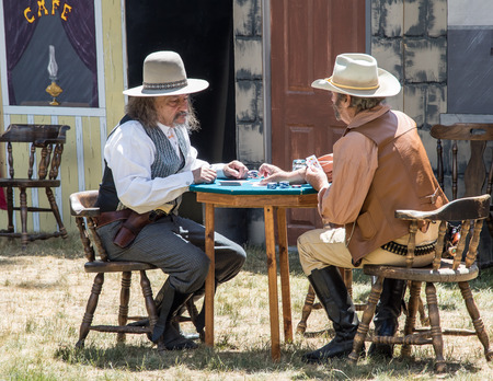 gunfighter: Graeagle, California, USA- July 4, 2015: The Nevada Gunfighters Wild West Theatrical Group performs a skit based on historical events in front of an audience at the Mohawk Independence Day Celebration in this small Northern California town.The Nevada Gunf
