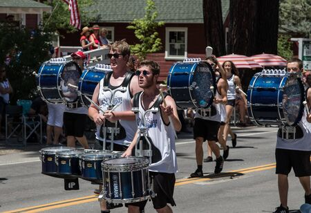 performing arts: Graeagle, California, USA- July 5, 2015: Drummers from the eNVision Performing Arts group thrill the crowd at the Mohawk Valley Independence Day Celebration parade in this small northern California town.