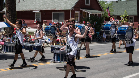 thrill: Graeagle, California, USA- July 5, 2015: Drummers from the eNVision Performing Arts group thrill the crowd at the Mohawk Valley Independence Day Celebration parade in this small northern California town.
