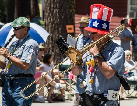 marching: Graeagle, California, USA- July 5, 2015: The Ophir Prison Marching and Kazoo Band performing while marching in the Mohawk Valley Independence Day Celebration in this small northern California town. Editorial