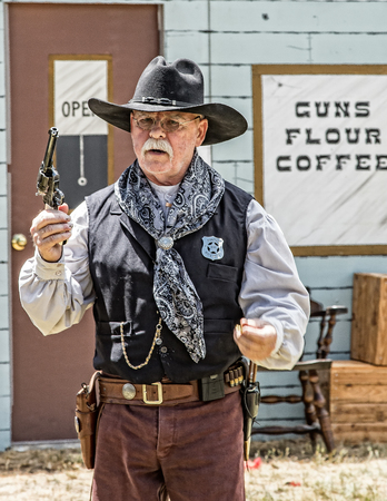 gunfighter: Graeagle, California, USA- July 4, 2015: A member of The Nevada Gunfighters Wild West Theatrical Group talk to the audience at the Mohawk Independence Day Celebration in this small Northern California town.The Nevada Gunfighters Wild West Theatrical Group Editorial