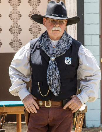 western usa: Graeagle, California, USA- July 4, 2015: A member of The Nevada Gunfighters Wild West Theatrical Group talk to the audience at the Mohawk Independence Day Celebration in this small Northern California town.The Nevada Gunfighters Wild West Theatrical Group Editorial