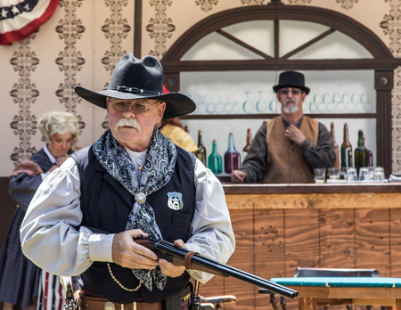 Graeagle, California, USA- July 4, 2015: A member of The Nevada Gunfighters Wild West Theatrical Group talk to the audience at the Mohawk Independence Day Celebration in this small Northern California town.The Nevada Gunfighters Wild West Theatrical Group Editoriali