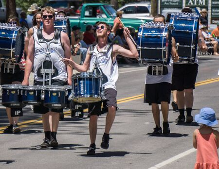 envision: Graeagle, California, USA- July 5, 2015: Drummers from the eNVision Performing Arts group thrill the crowd at the Mohawk Valley Independence Day Celebration parade in this small northern California town.