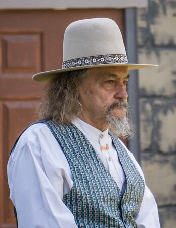 gunfighter: Graeagle, California, USA- July 4, 2015: A member of The Nevada Gunfighters Wild West Theatrical Group talks to the audience at the Mohawk Independence Day Celebration in this small Northern California town.The Nevada Gunfighters Wild West Theatrical Grou