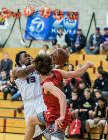 foothill: A Shasta player white pulls down a rebound against Foothill during a basketball game in Redding, California.