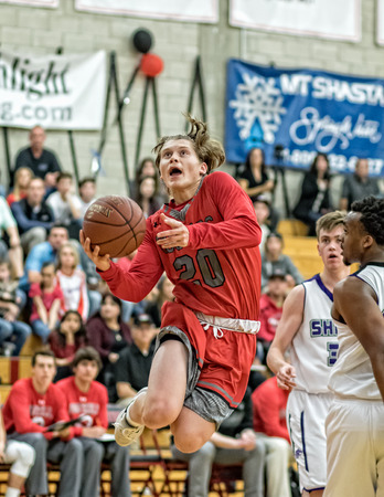 foothill: A Foothill player red throws up a shot  during a basketball game in Redding, California