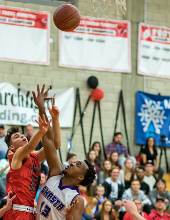 basketball game: Foothill and Shasta players compete for a rebound during a basketball game in Redding, California
