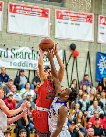 basketball game: Shasta and Foothill players competing for a rebound during a basketball game in Redding, California. Editorial