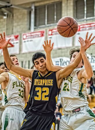 placer: Tough game, Basketball match between Placer and Enterprise, Redding, California. Editorial