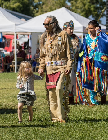 powwow: Native American Dancer and grandchild at the Stillwater Pow-wow, Anderson, California. Editorial