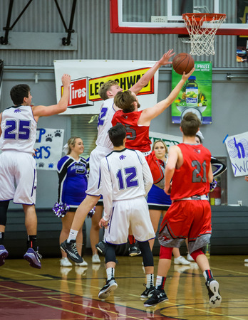 teammates: A Foothill player red goes up for a shot against Foothill A Shasta player white is looking for teammates to pass toA Shasta player white looks to pass in a game with Foothill  during a basketball game in Redding, California. Editorial
