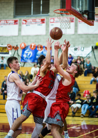 foothill: Players from Shasta white and Foothill fight for a rebound   during a basketball game in Redding, California.