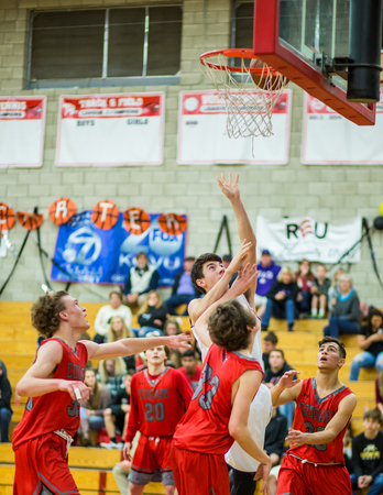 A Shasta player white makes a shot against the Foothill defense Players from Shasta white and Foothill fight for a rebound   during a basketball game in Redding, California. Editöryel