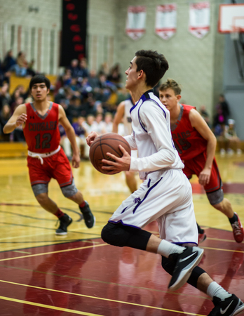 basketball game: A Shasta player heads for the score  during a basketball game in Redding, California.