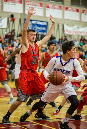 foothill: A Shasta player white looks to pass in a game with Foothill  during a basketball game in Redding, California.
