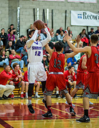 foothill: A Shasta player takes a shot with Foothill defending  during a basketball game in Redding, California. Editorial