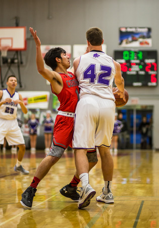 foothill: A Foothill player red  defends  against a  Shasta  player, during a basketball game in Redding, California.