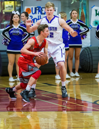 foothill: A Foothill player red  dribbles the ball up against the Shasta  defenders, during a basketball game in Redding, California.