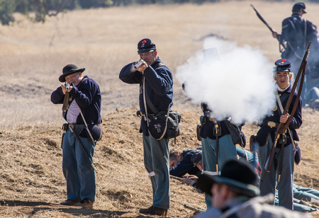 Union and Confederate soldiers engage in battle, Civil War reenactment, Anderson, California.