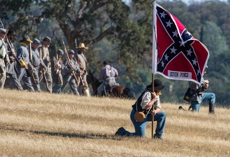 reenactment: Confederates advance , Civil War Reenactment at Anderson, California. Editorial