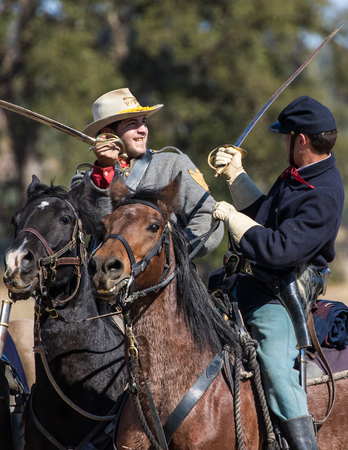 Union and Confederates engage in combat, Civil War reenactment, Anderson, California.