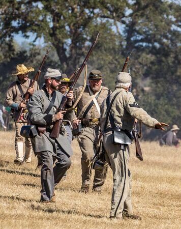 reenactment: Rebels move up , Civil War Reenactment at Anderson, California. Editorial