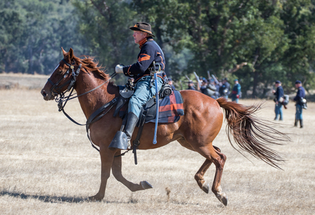 cavalry: Union cavalry Scout advances towards the  enemy at a Civil War reenactment, Anderson, California. Editorial