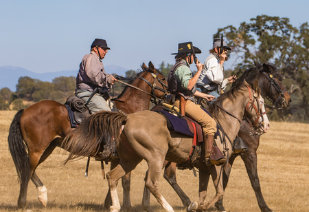 cavalry: Confederate cavalry scouts move up to the front lines at a Civil War reenactment, Anderson, California. Editorial