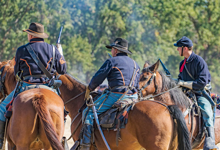 cavalry: Three  Union cavalry Scouts observe the enemy at a Civil War reenactment, Anderson, California. Editorial