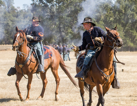 cavalry: Two Union cavalry Scouts observe the enemy at a Civil War reenactment, Anderson, California.