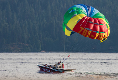 Para Sailing over Lake Coeur dAlene, Idaho Editorial