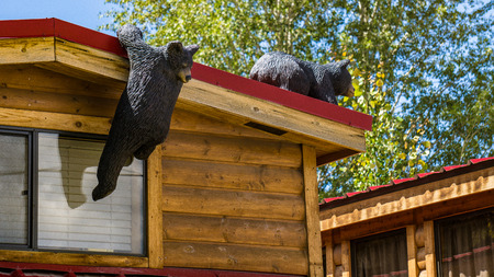Carving of curious black bears on a cabin in Jackson, Wyoming.