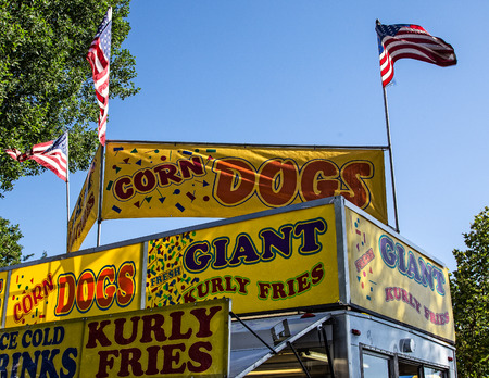 concession: Anderson, California, USA- June 17, 2015: Lots of snacks are advertised for sale on the midway of this carnival at the Shasta County Fair. Editorial