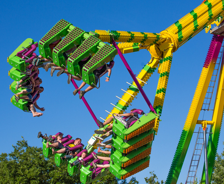 carnival ride: Anderson, California, USA- June 17, 2015: Fair goers enjoy the carnival ride Freak Out at the Shasta County FairThe Freak Out is a pendulum shaped ride that is very popular.