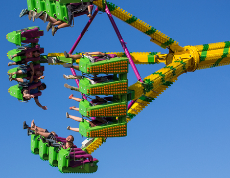 freak out: Anderson, California, USA- June 17, 2015: Fair goers enjoy the carnival ride Freak Out at the Shasta County FairThe Freak Out is a pendulum shaped ride that is very popular.