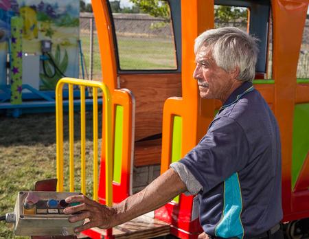 carny: Train Conductor, Shasta County Fair, Anderson, California. Editorial