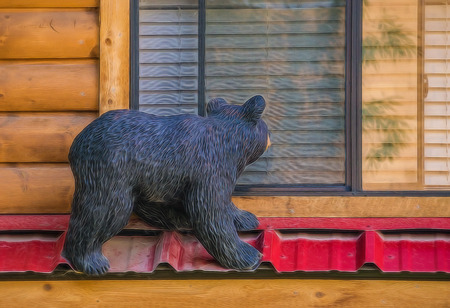 Carving of a curious  black bear on a cabin in Jackson, Wyoming.