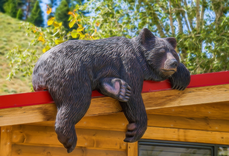 Carving of a sleeping black bear on a cabin in Jackson, Wyoming.