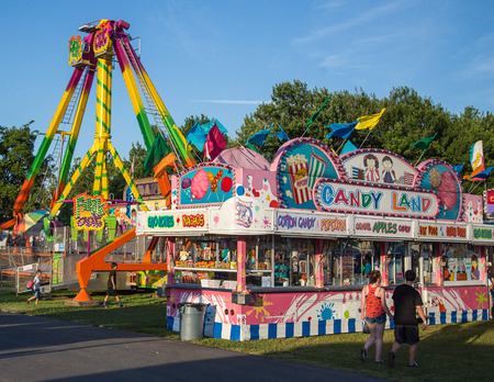 advertised: Anderson, California, USA- June 17, 2015: Lots of snacks are advertised for sale on the midway of this carnival at the Shasta County Fair. Editorial