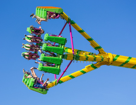 carnival ride: Fair goers enjoy the carnival ride Freak Out at the Shasta County FairThe Freak Out is a pendulum shaped ride that is very popular. Editorial