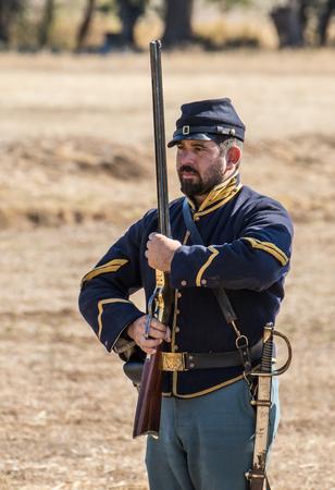 reenactment: Union Army reenactor,  Civil War Reenactment at Anderson, California.
