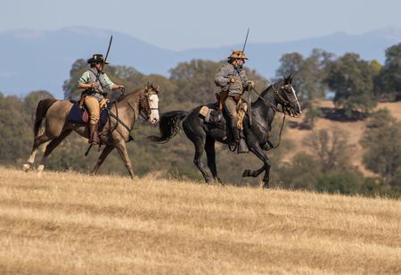 reenactment: Confederate Cavalry Scouts Advance, Civil War Reenactment at Anderson, California. Editorial