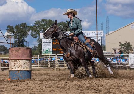 pima: Barrel Racer Turns the Corner,  Cottonwood Rodeo, California Editorial