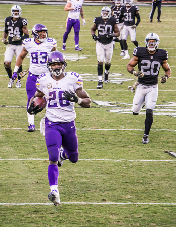 raider: Adrian Peterson   28 runs 80 years into  the end zone in a football game in Raider Stadium, Oakland, California.