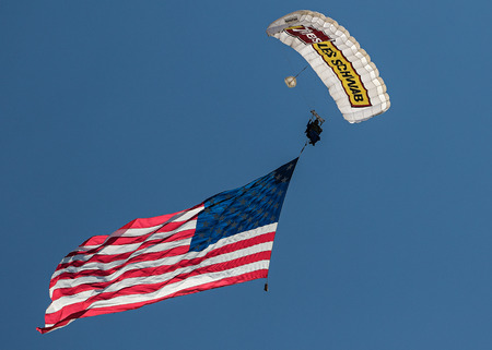 bluff: Skydiver with American Flag, Red Bluff Rodeo